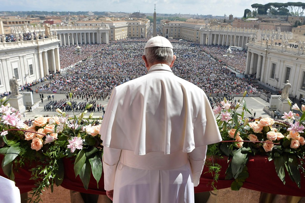 """. Pope Francis addresses the crowd prior to delivering his Urbi et Orbi (to the city and to the world) message from the main balcony of St. Peter\'s Basilica, at the Vatican, Sunday, April 16, 2017.  On Christianity\'s most joyful day, Pope Francis lamented the horrors generated by war and hatred, delivering an Easter Sunday message that also decried the \""""latest vile\"""" attack on civilians in Syria. (L\'Osservatore Romano/Pool Photo via AP)"""