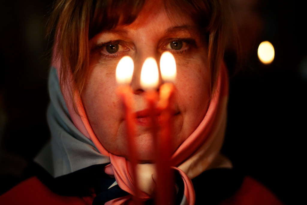 . A Russian Orthodox believer holds candles during the Easter service in Christ the Savior Cathedral in Moscow, Russia, early Sunday, April 16, 2017. (AP Photo/Ivan Sekretarev)