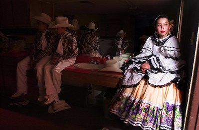Paul Conrad/The Aspen Times Watching others of her dance team rehearse, Folklorico Mexicano dance team member Ashley Venture,12, of El Jebel watches others rehearse at Basalt Middle School while waiting to perform during Cinco de Mayo celebrations Friday morning May 5, 2006. The Aspen Santa Fe Ballet sponsored dance troup performed througout the valley at area schools.