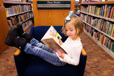 Paul Conrad The Aspen Times Kicking back for a good read, Lillian Cassidy, 5, of New York City browses through the children's selections Wednesday afternoon Mar. 19, 2008, at the Evelyn Flug Children's Library at the Pitkin County Library in Aspen, Colo.