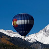 "Paul Conrad/Aspen Times Weekly<br /> With fresh snow on Capitol Peak, left, and Mount Daly, Patrick Carter of Pueblo pilots his trademark ""Colorado High"" hot air balloon over Snowmass Village Sunday morning during the 31st annual Snowmass Balloon Festival."