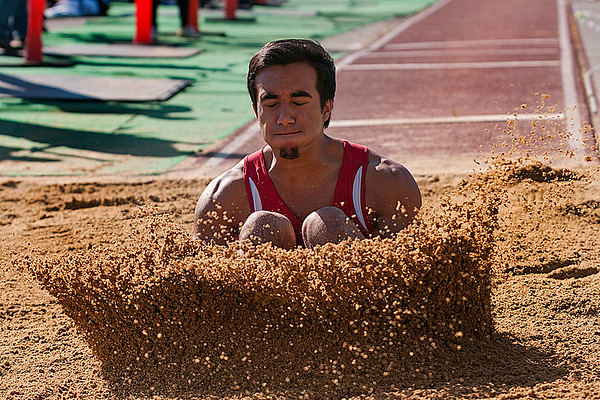 © Paul Conrad/ Pablo Conrad Photography - Bellingham High School senior Christian Amano of Bellingham, Wash,. lands in the pit during his attempt at the long jump druing the NWC Track & Field competition at Civic Field in Bellingham. Amano ended 8th overall with a distance of 18 feet, 11 inches.