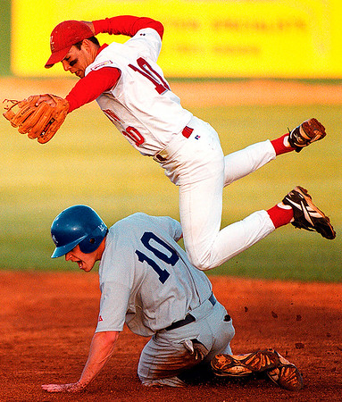 Daily News/ Paul Conrad      MTSU@WKU   Western's Luis Rodriguez jsumps over Middle Tennessee's Kyle Thomas as he slides safely into second base during the forth inning at Nick Denes Field on Western's Campus.