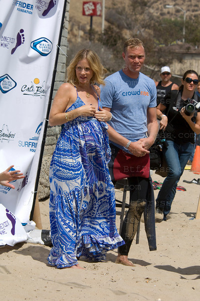 Pregnant Christina Applegate and her fiance Martin LeNoble during the Surfrider Competition 2010 in Malibu,California. They exepting their baby soon.