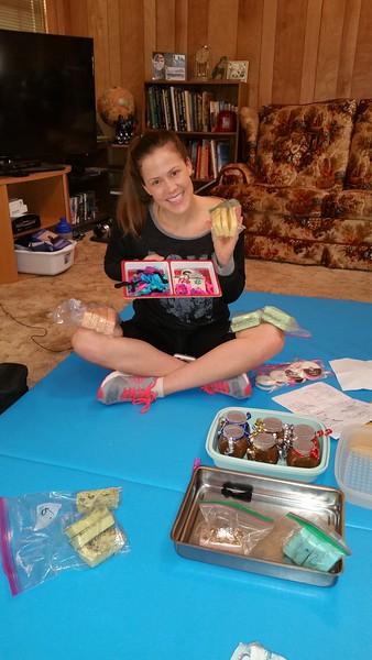 Sarah showing off her hand made gifts. - Herbal soaps, Sugar Scrubs, Hair Ties.  Great job Sarah!