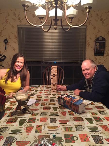 Sarah and Dad facing off in a hard nose game of Jenga.