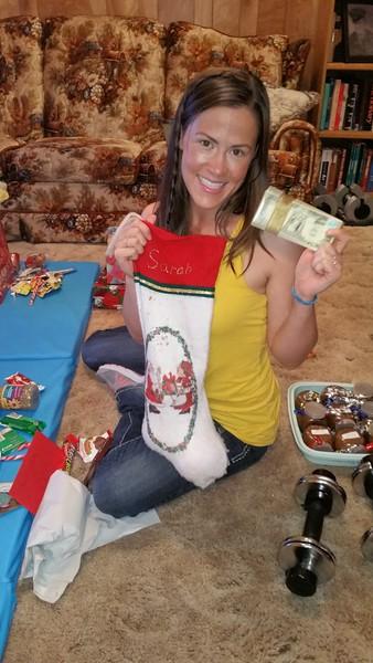 Sarah Jane holds her stocking.