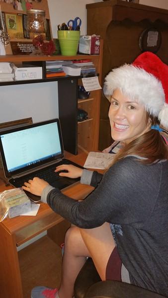 Sarah working at the omputer.