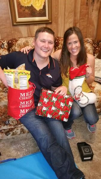 Adam and Sarah display their Christmas loot.