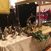 Nativity set, villagers and townspeople on left, the Holy Family in their house