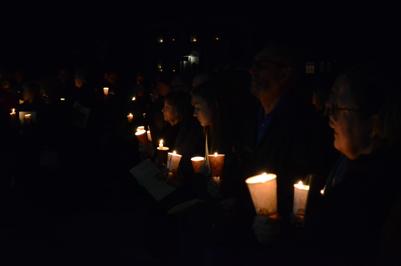 """DAVID LACHANCE — BENNINGTON BANNER<br /> Sores of people sing """"Silent Night"""" after a candlelight Christmas Eve service at the Old First Church in Bennington on Tuesday night."""