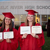 Mathea graduates from high school-with friend Kacie