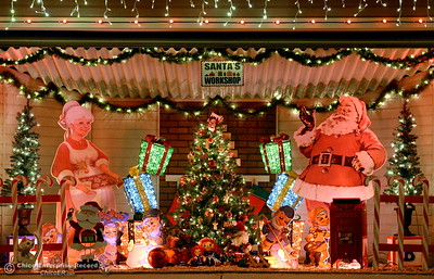 Two homes with notable Christmas Light displays sit side by side along Ceanothus Ave. with garages turned into religious and Santa based displays in Chico, Calif. Tues. Dec. 6, 2016. (Bill Husa -- Enterprise-Record)