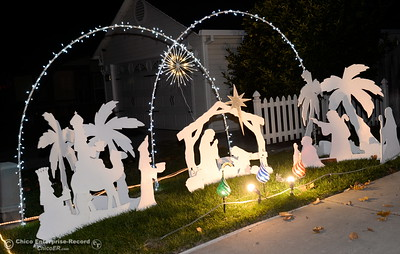 Christmas Lights and inflatable figures bring two yards side by side along Whitewood Way to life in Chico, Calif. Tues. Dec. 6, 2016. (Bill Husa -- Enterprise-Record)