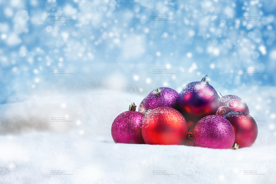 Christmas balls with snow on blue background