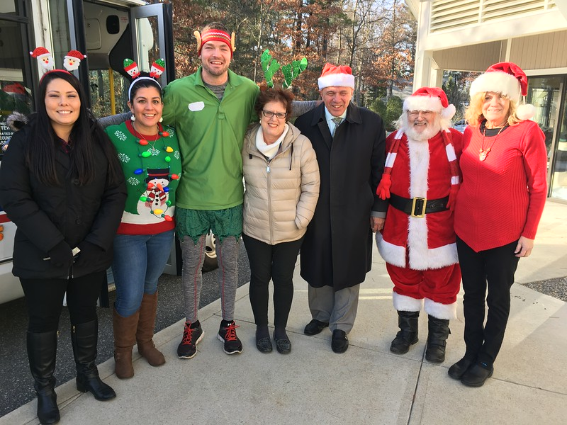 tewksbury town employees came together tuesday to deliver gifts to seniors in town as part of