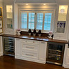 A custom-made maple bar with Brazilian stained cherry hardwood floor