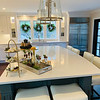 The blindingly white kitchen with oversized custom island