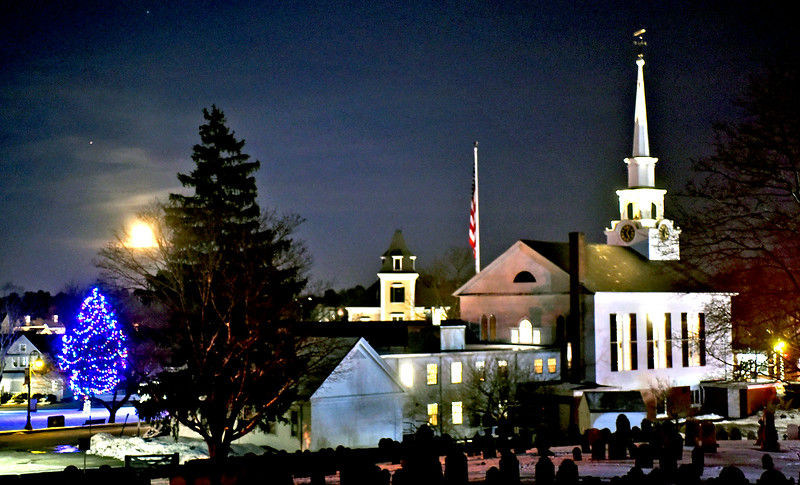 A almost full moon comes up over this holiday scene of Chelmsford Center. SUN/ David H. Brow