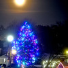 An almost full moon raising up over a lit Holiday tree on Chelmsford Common. SUN/ David H. Brow