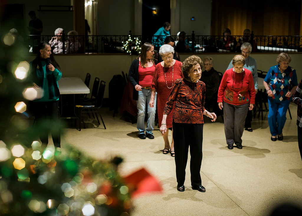 . A crowd dances along to the music of the band Rhythm during a Christmas luncheon for seniors at the Knights of Columbus in Leominster on Wednesday, December 6, 2017. SENTINEL & ENTERPRISE / Ashley Green
