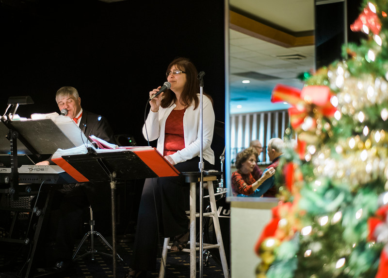 Steve Infantino and Donna Burkhart, of the band Rhythm, perform while couples sway on the dance floor during a Christmas luncheon for seniors at the Knights of Columbus in Leominster on Wednesday, December 6, 2017. SENTINEL & ENTERPRISE / Ashley Green