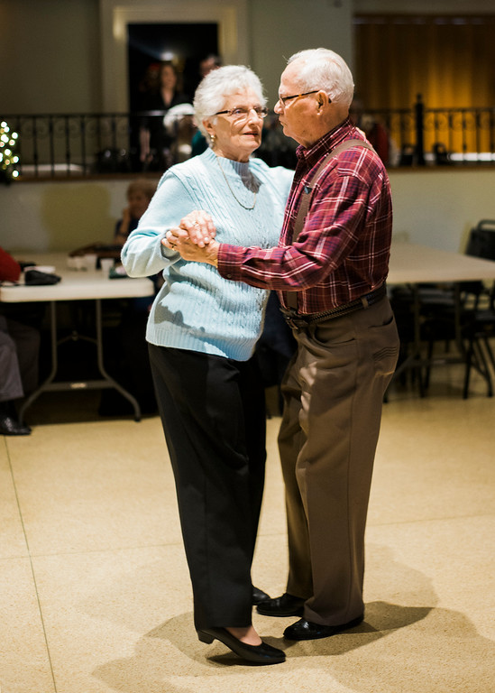 . Bernie and Pat Garder, of Leominster, dance along to the music of the band Rhythm during a Christmas luncheon for seniors at the Knights of Columbus in Leominster on Wednesday, December 6, 2017. SENTINEL & ENTERPRISE / Ashley Green