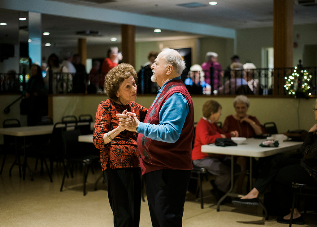. Virginia Salvi and Joe Brindisi, of Leominster, dance along to the music of the band Rhythm during a Christmas luncheon for seniors at the Knights of Columbus in Leominster on Wednesday, December 6, 2017. SENTINEL & ENTERPRISE / Ashley Green