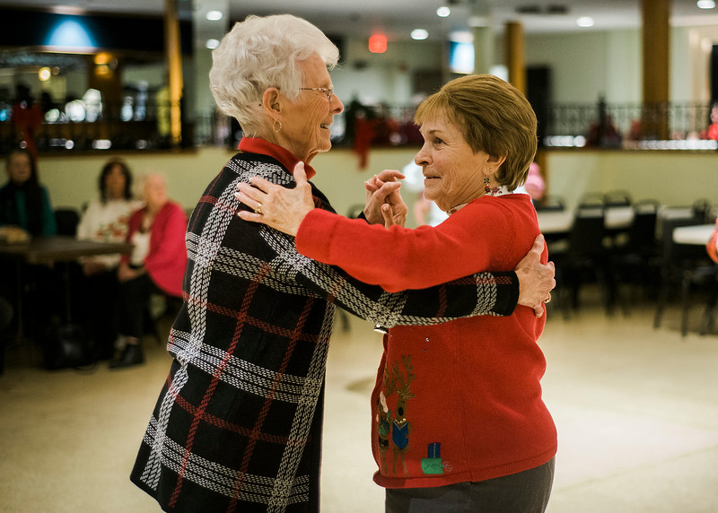 Yvonne Nickerson, of Fitchburg, and Loretta Les, of Leominster, dance along to the music of the band Rhythm during a Christmas luncheon for seniors at the Knights of Columbus in Leominster on Wednesday, December 6, 2017. SENTINEL & ENTERPRISE / Ashley Green