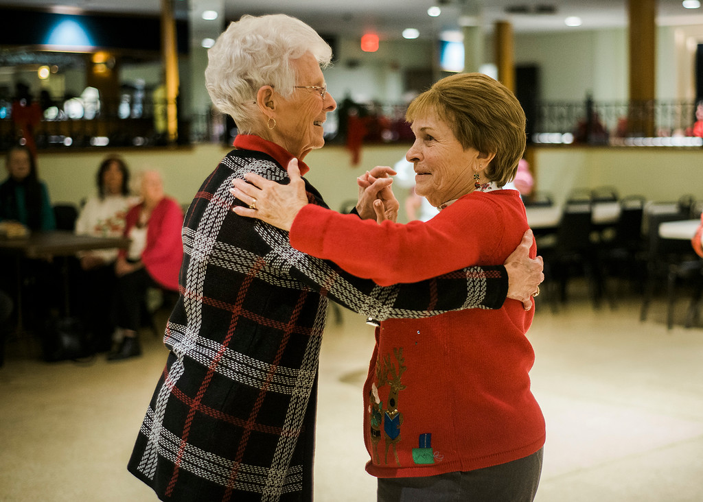 . Yvonne Nickerson, of Fitchburg, and Loretta Les, of Leominster, dance along to the music of the band Rhythm during a Christmas luncheon for seniors at the Knights of Columbus in Leominster on Wednesday, December 6, 2017. SENTINEL & ENTERPRISE / Ashley Green