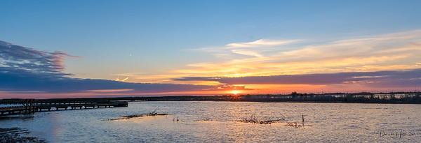 The Sun breaks over the horizon at Shoveler's Boardwalk