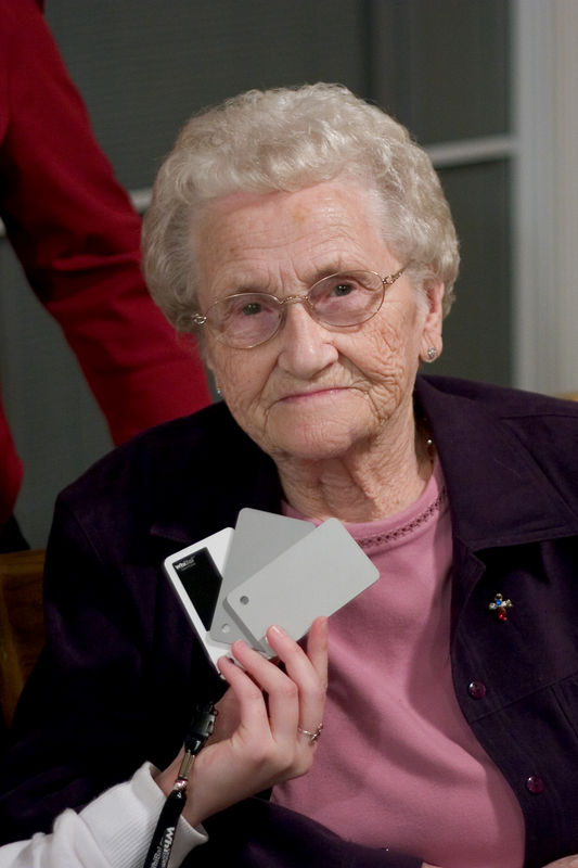 My grandma Evelyn, with my white card. I usually don't post these types of pictures, but hey, it's my grandma! (Raw colour balancing.)