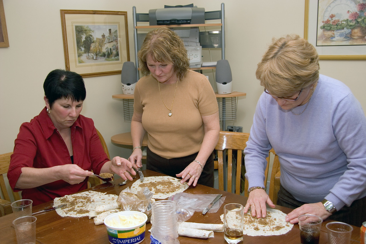 """Some of the aunts making <a href=""""http://www.fromnorway.net/norwegian_food/recipes/recipelefse.htm"""" target=_blank>lefse</a> with brown sugar."""