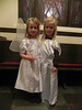 Two angels await the service.