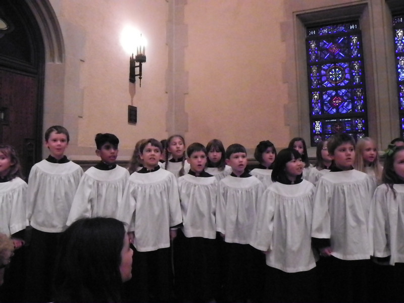 """Wesley Singers sing the prelude, """"Go Tell it on the Mountain,"""" before joining the Choristers and Treble choir in the choir loft."""