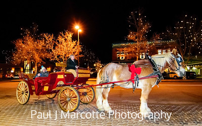 Family of 4 on a magical carriage in Old town