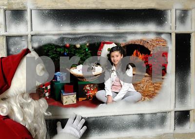 Santa in Window Chica