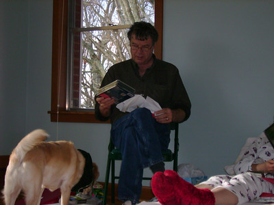 Gene opening a gift.