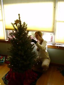 Kelly decorating the tree.