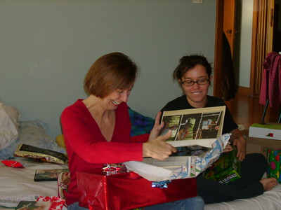 Leisa opening a gift.