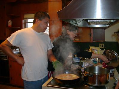 Michael helping Portia cook . . . shrimp.