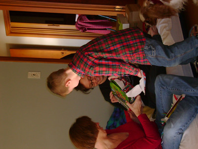 Eli opening a gift.