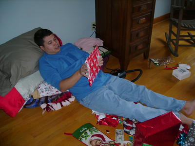 Michael opening a gift.