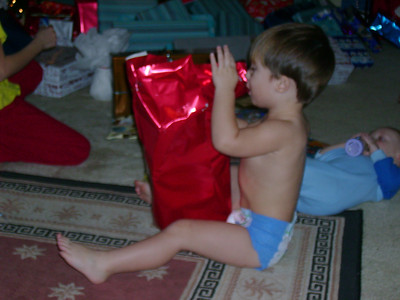 Tate opening a gift.