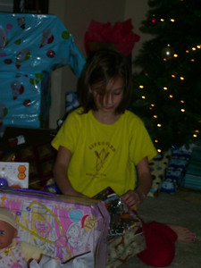 Summer opening up her new baby doll.