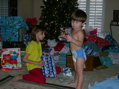Summer and Tate with gifts.