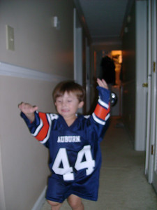 Tate running down the hall with his new Auburn University # 44 Tate jersey.