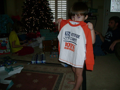 Tate holding up his new shirt.