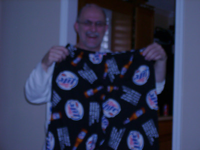 Mike holding his new pj bottoms.