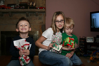 Tate, Summer and Aiden readying to open gifts from Aunt Kelly and Uncle Mikey.
